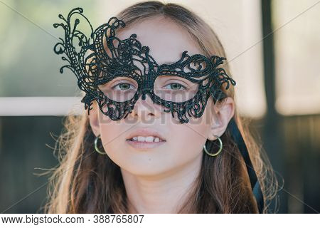 Blond Girl Outdoors. Halloween. Teenage Girl In Park. Girl In A Masquerade Mask. Portrait Of A Beaut