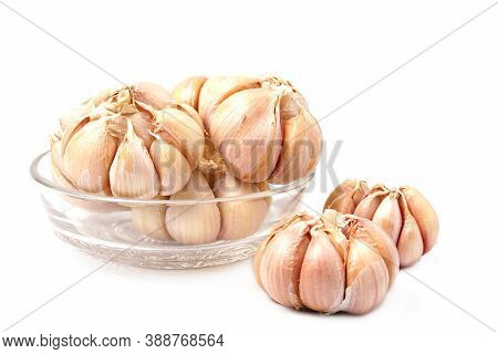 Garlic Cloves And Bulb In Glass Bowl Isolated On White Backgroound. Fresh Gralic Cloves. Pile Of Gar