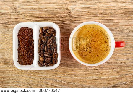 Ground Coffee And Roasted Coffee Beans In Partitioned White Bowl, Cup With Coffee Espresso On Wooden