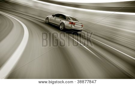 3d rendering of a brandless generic car of my own design in a tunnel with heavy motion blur poster