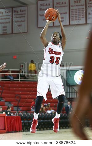 NEW YORK-NOV 3: St. John's Red Storm guard Shenneika Smith (35) shoots against the Farmingdale Rams at Carnesecca Arena on November 3, 2012 in Jamaica, Queens,  New York.