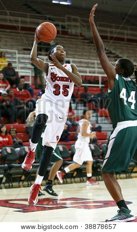 NEW YORK-NOV 3: St. John's Red Storm guard Shenneika Smith (35) shoots over Farmingdale Rams center Wabiyn Ati (44) at Carnesecca Arena on November 3, 2012 in Jamaica, Queens, New York.