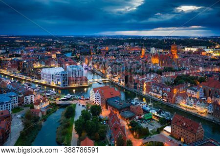 Aerial view of the Gdansk city over Motlawa river with amazing architecture at dusk,  Poland
