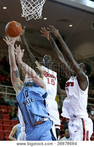 NEW YORK-NOV 3: Sonoma State Seawolves forward Brandon Glanz shoots as St. John's Red Storm guard Sir'Dominic Pointer (15) defends at Carnesecca Arena on November 3, 2012 in Jamaica, Queens, New York.