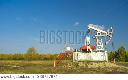Oil Rigs-rocking On The Oil Field Near The Road. Oil Rig. Copy Space.