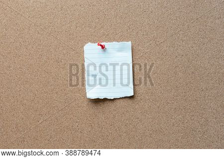 Note Paper With Tack On A Cork Bulletin Board