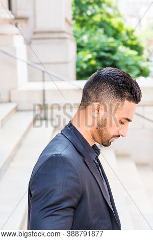 Portrait Of Young East Indian American Businessman With Beard In New York City, Wearing Black Suit,