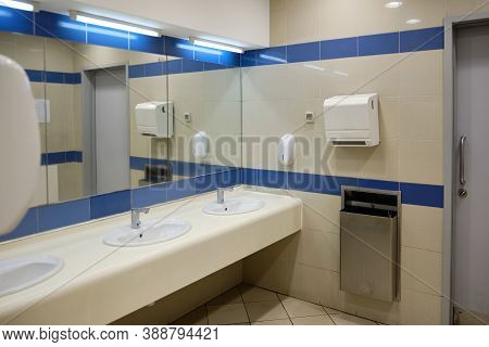 Washbasins And Hand Dryers In The Public Toilet