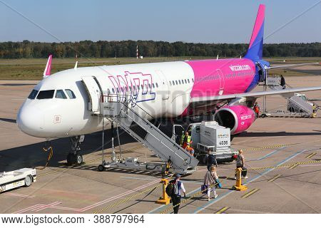 Cologne, Germany - September 22, 2020: Passengers Board Wizzair Airbus A321 At Cologne/bonn Airport,