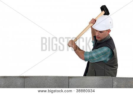 Tradesman using a mallet