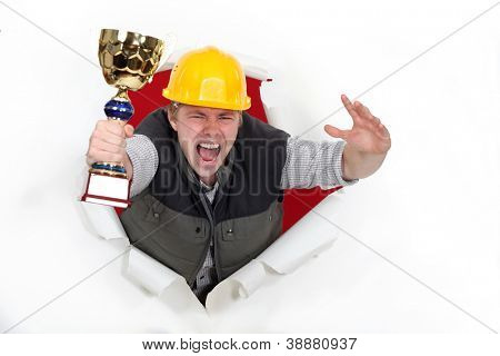 young craftsman holds trophy shouting for joy