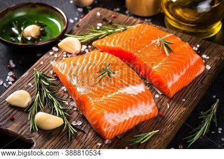 Raw Salmon Fish, Fresh Salmon Fillet At Cutting Board With Ingredients For Cooking.