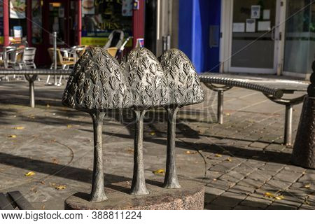 Doncaster,yorkshire, England - October 7, 2020. Three Small Bronze Trees Near Public Benches For Peo