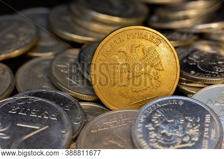 Coin 10 Rubles Lies Between Other Rubles. It Is Golden Color Ruble