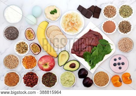 Health food & herbal medicine to help heal bipolar disorder & manic depression with foods high in omega 3, protein, vitamins, selenium, magnesium, serotonin & tryptophan. Flat lay on marble.