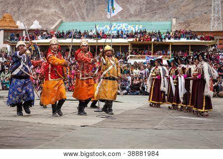LEH, INDIA - SEPTEMBER 08: Dancers in traditional Ladakhi Tibetan costumes perform warlike dance at the Annual Festival of Ladakh Heritage in Leh, India. September 08, 2012