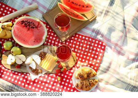 Picnic Blanket With Delicious Food And Drinks Outdoors On Sunny Day, Flat Lay