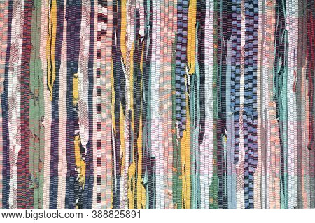 Fabric Scraps, Old Clothing And Textiles Are Cut Into Strips And Grouped Together, Forming Diagonal