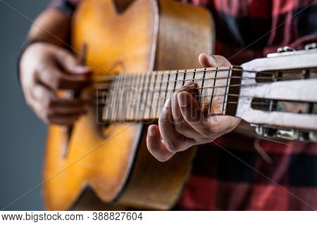 Mans Hands Playing Acoustic Guitar, Close Up. Acoustic Guitars Playing. Music Concept. Guitars Acous
