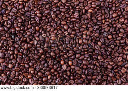 Freshly Roasted Coffee Beans Background. Coffee Beans Background. Background Of Roasted Coffee Beans
