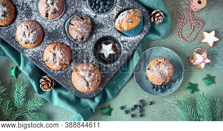 Christmas Blueberry Muffins In A Baking Tray. Panoramic Top View Image With Xmas Decor