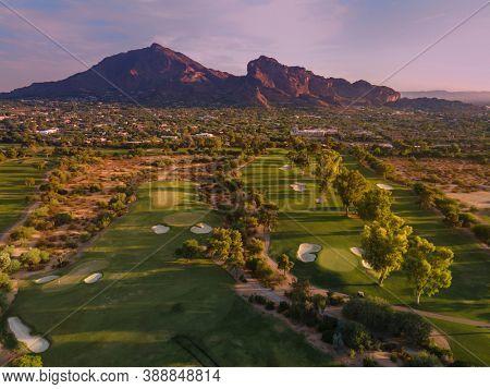 Late evening sun glowing red on Camelback Mountain in Phoenix, Scottsdale, Arizona,USA
