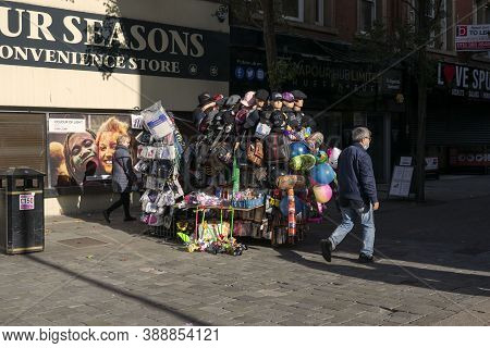 Doncaster,yorkshire, England - October 7, 2020. People Walking On The Street Near A Mobile Stand Tha