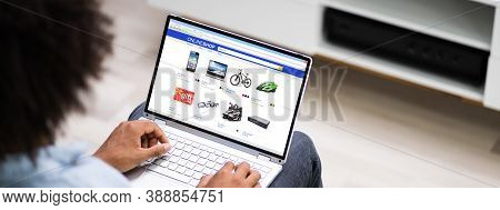 African American Ecommerce Online Shopping On Laptop