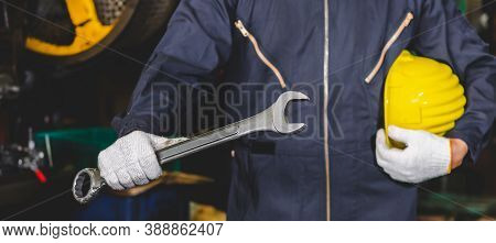 Factory Engineer Holding A Hard Hat And A Wrench In Uniform To Ready Service And Working Inside The