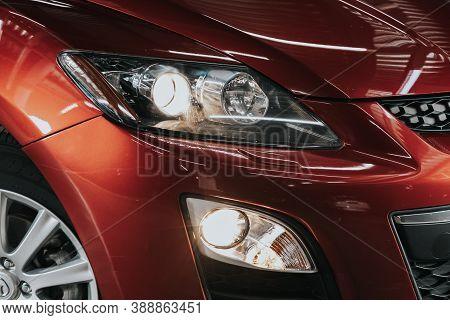 Novosibirsk, Russia - October 08, 2020: Mazda Cx-7,  Red Car Headlights. Exterior Detail. Close Up D