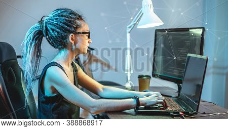 Modern Young Female Programmer Is Writing Program Code On A Laptop At Home. The Concept Of Software