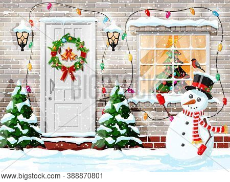 Christmas Facade Decoration. Entrance To Suburban House Decorated With Wreath, Bells, Garland Lights