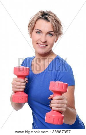 Cute mid aged women do exercises with dumbbells isolated on a white