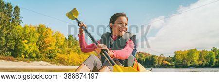 Kayak tour adventure fun on river in Quebec, Canada. Summer travel destination. Happy Asian woman kayaker paddling kayaking in lake.