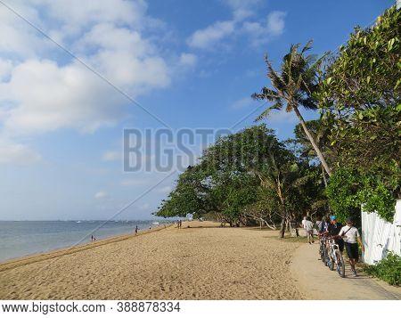 Denpasar, Indonesia - September 29, 2019: Some People Having Activities On Sanur Beach Boardwalk Alo