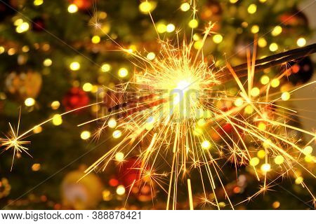 Bengal Light.sparkler Sparks.christmas And New Year Festive Background. Bengal Fire On A Festive Chr