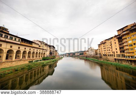 The Uffizi Gallery And The Arno River Taken From The Ponte Vecchio Bridge On The Arno River In Flore