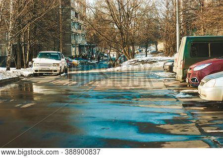 Snow Melts On The Road In Winter, Moscow