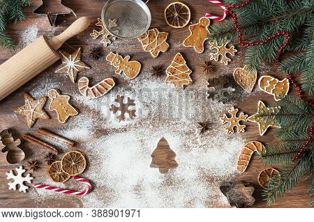 Christmas Homemade Gingerbread Cookies On Wooden Background Top View With Copy Space.