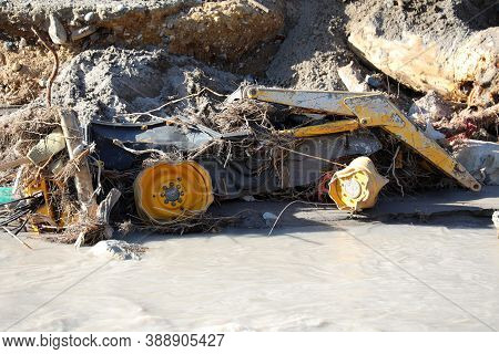 Town Of Breil-sur-roya Was Submerged By The Flooding Of The Roya River, Yellow Tractor Completely De