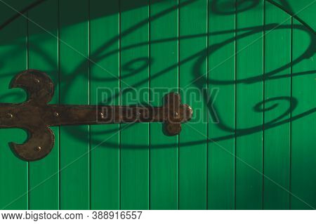 Detail Of Forged Iron Latch. Handwork Forging. Green Door