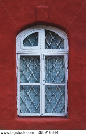 Unusual Window Of Old House. Vintage Architecture. Exterior Of Ancient Building
