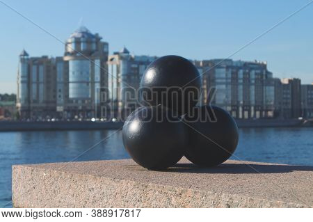 Old Cannonballs On The Embankment As A Monument