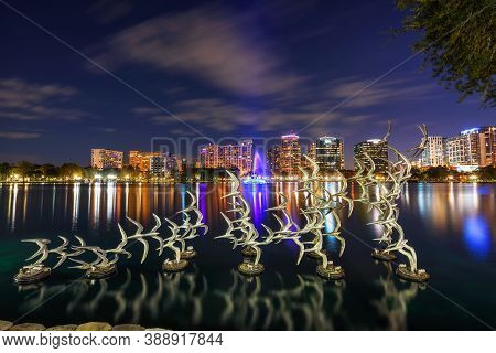 Orlando, Florida, Usa - January 10, 2020 : Flying Birds Sculpture In Lake Eola Park With City Skylin