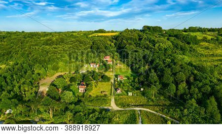 View Over Forest, Hilly Landscape With Cottage Settlement, Several Cultivated, Arable Plots, Dirty R