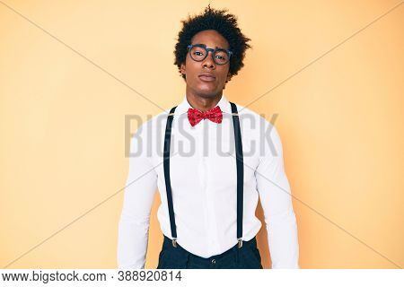Handsome african american man with afro hair wearing hipster elegant look relaxed with serious expression on face. simple and natural looking at the camera.