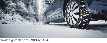 The Car Stopped On The Snowy Roadside