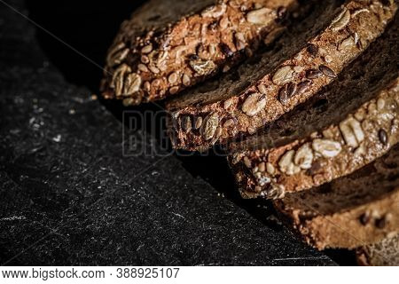 Fresh Whole Grain Seeded Bread, Organic Wheat Flour, Closeup Slice Texture As Background For Food Bl