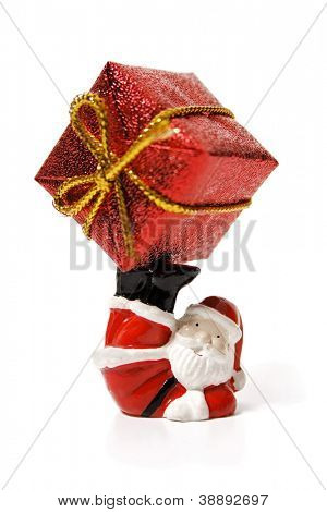 Santa Claus playig with a big gift on a white background.
