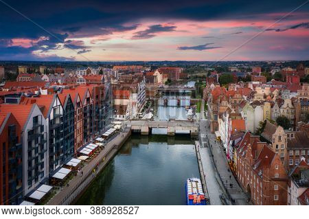 Aerial view of the Gdansk city over Motlawa river with amazing architecture at sunset,  Poland